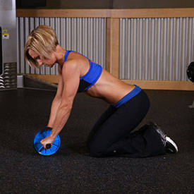 Shoulder roll-out on knees with ball