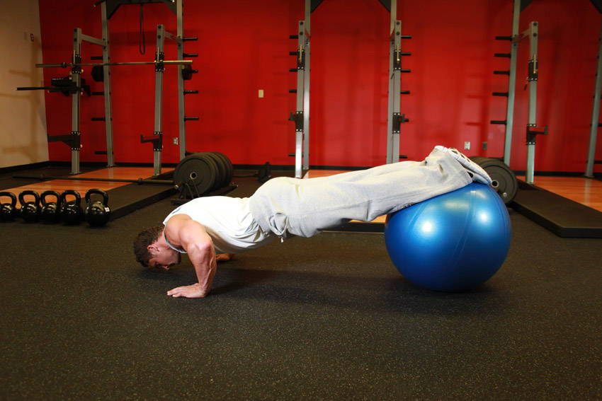 Push-Ups With Feet On An Exercise Ball image