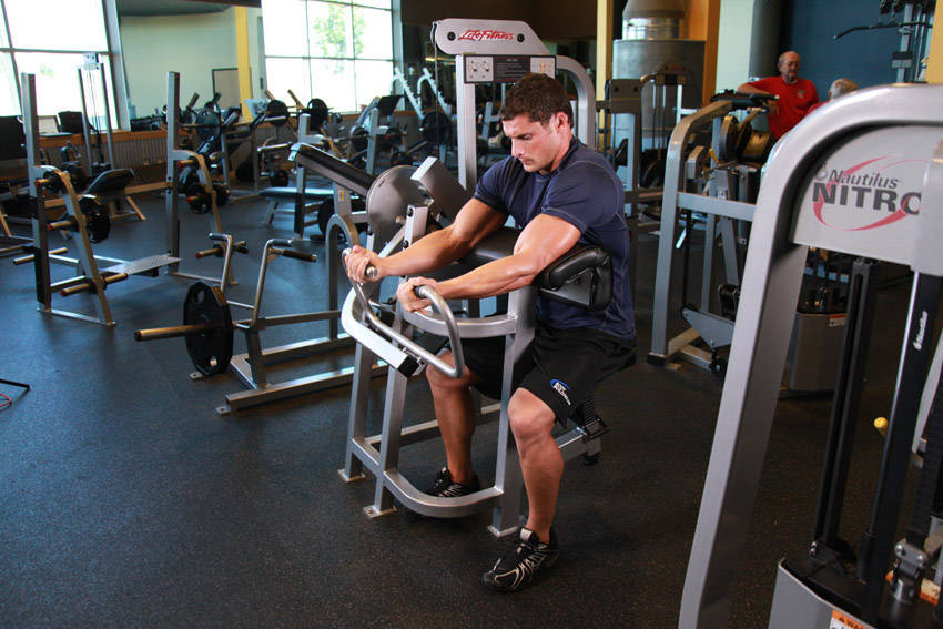 Machine Preacher Curls Exercise Guide and Video
