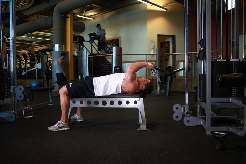 Cable Extension Exercise : Cable lying triceps extension exercise guide and video