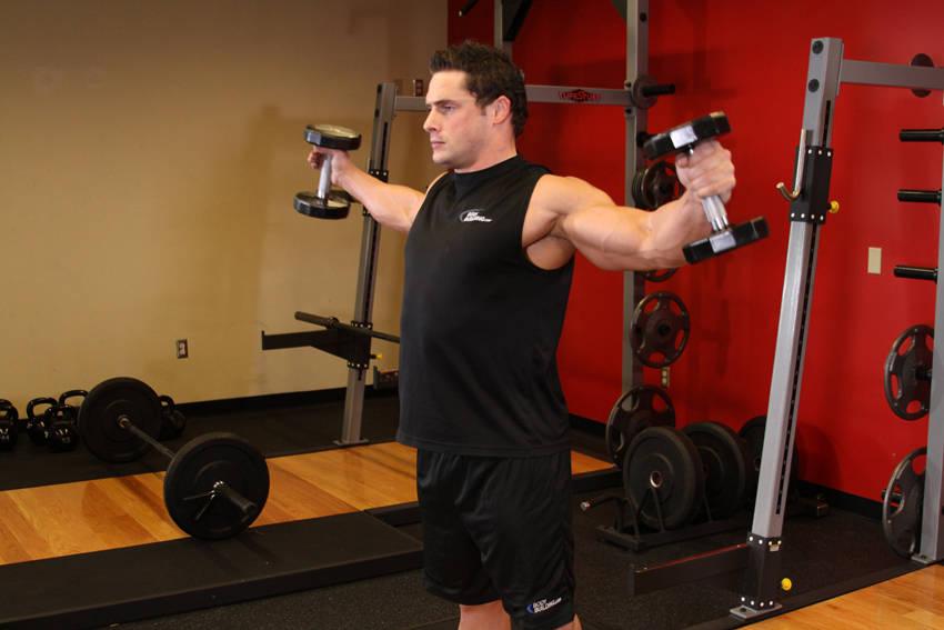 Dumbbell iron cross squat image