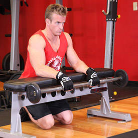 Palms-Down Wrist Curl Over A Bench