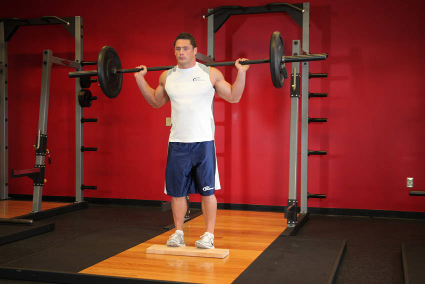 Standing Barbell Calf Raise Exercise Guide and Video