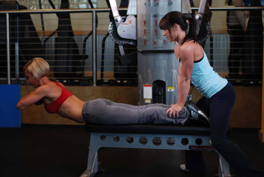 Hyperextensions With No Hyperextension Bench Exercise Guide And Video