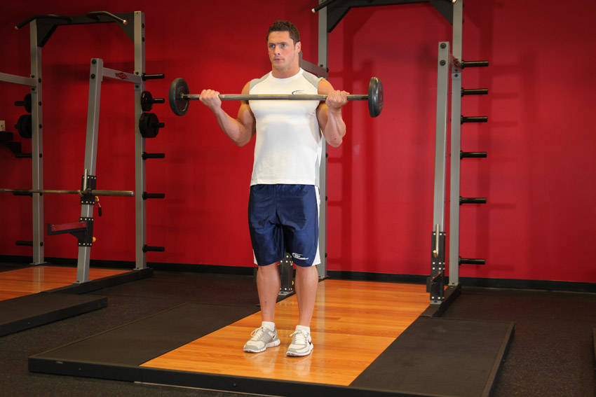Wide-Grip Standing Barbell Curl Exercise Guide and Video
