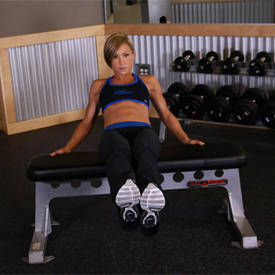 seated leg tucks exercise guide and video