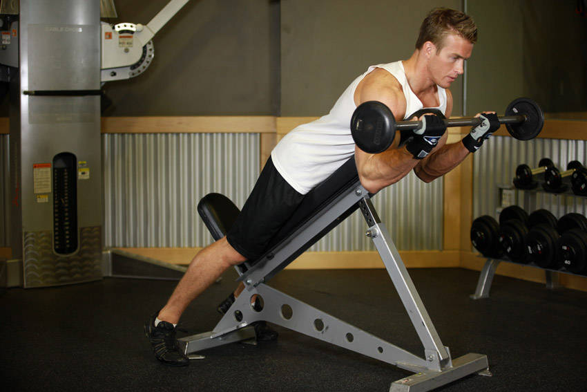 Barbell Curls Lying Against An Incline image