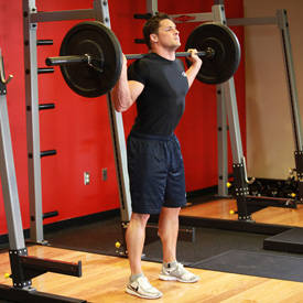 Close-stance barbell squat (barefoot)