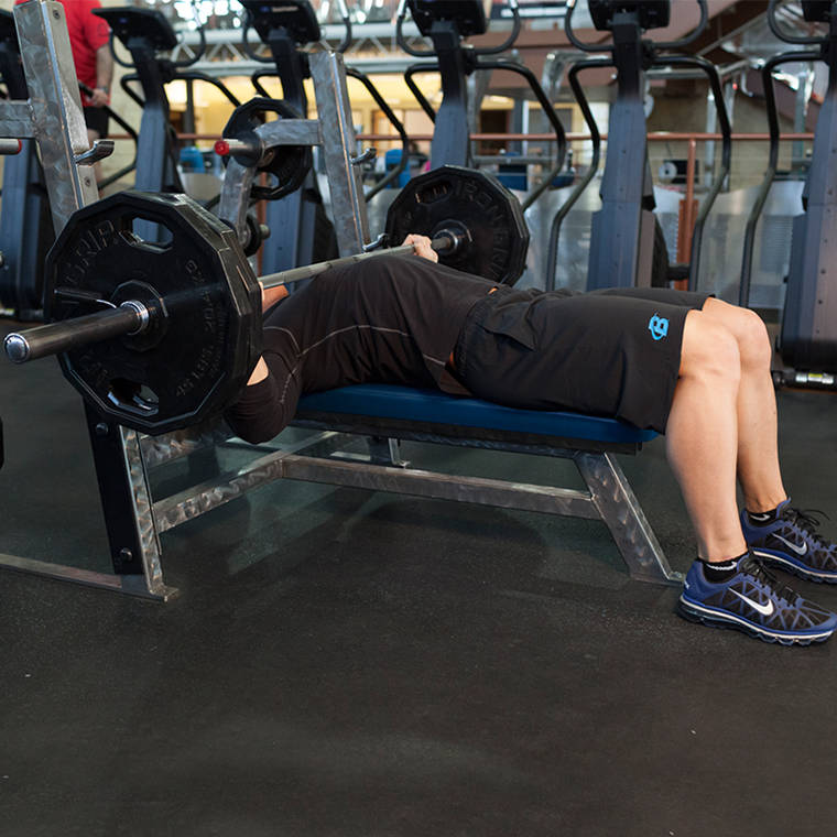 Single Arm Dumbell Bench Press: Barbell Bench Press-Wide Grip Exercise Guide And Video