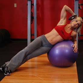 Oblique crunch on ball with medicine ball