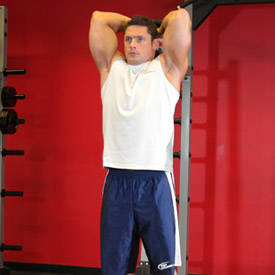 Standing overhead dumbbell triceps press