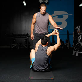 Partner-assisted weighted sit-up