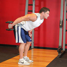 Standing bent-over single-arm dumbbell triceps extension