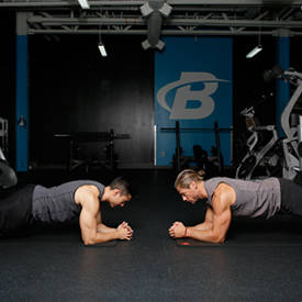 Partner Facing Planks With Alternating High-Five