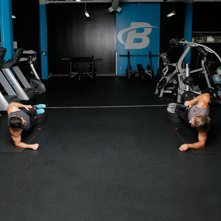 Partner Facing Feet-Elevated Side Plank With Band Row image