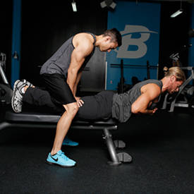 Partner-resisted bench reverse hyperextension