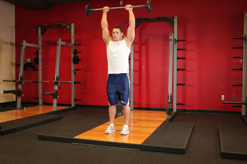 Standing Front Barbell Raise Over Head Exercise Guide and Video