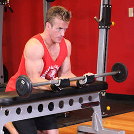 Palms-Up Barbell Wrist Curl Over A Bench