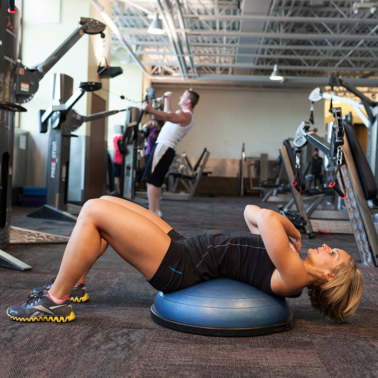 Stability Ball Knee Crunches: Bosu Ball Crunch Exercise Guide And Video
