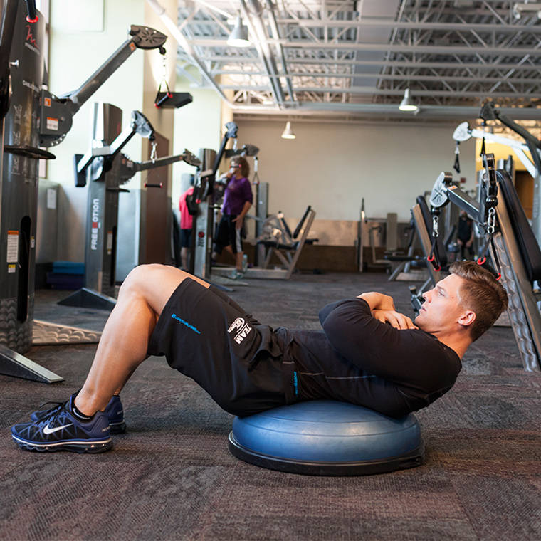 Bosu Ball Oblique Crunches: Bosu Ball Crunch Exercise Guide And Video