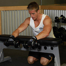 Palms-down dumbbell wrist curl
