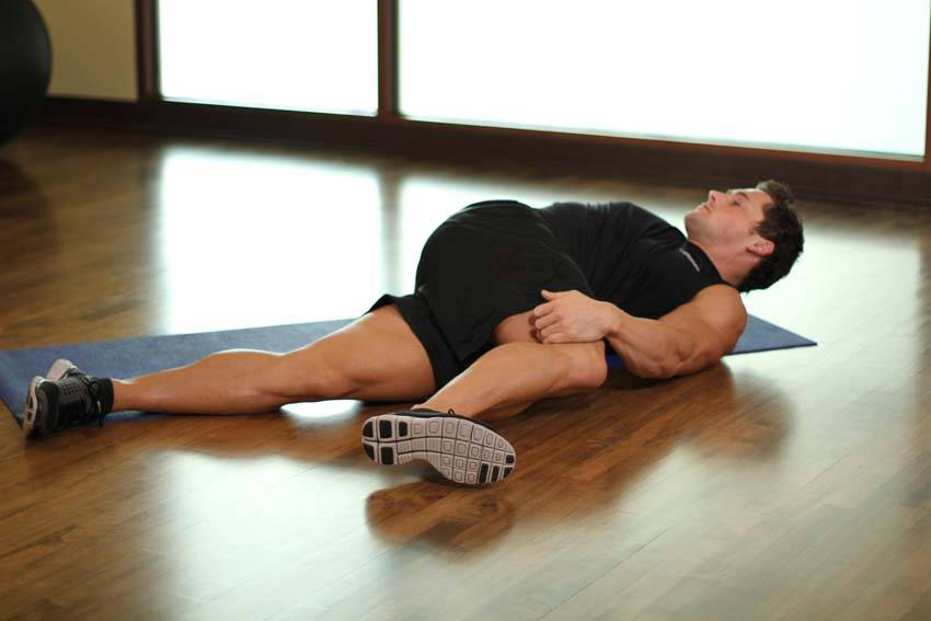 Knee Across The Body Exercise Guide and Video