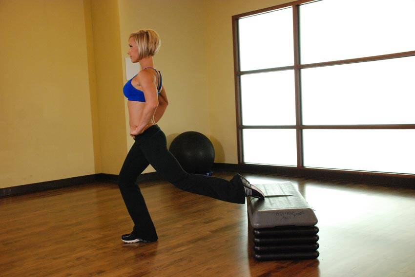 Standing Elevated Quad Stretch Exercise Guide And Video