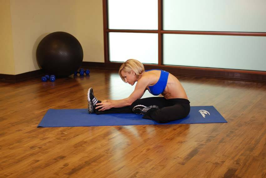 Seated floor hamstring stretch exercise guide and video for Floor exercises
