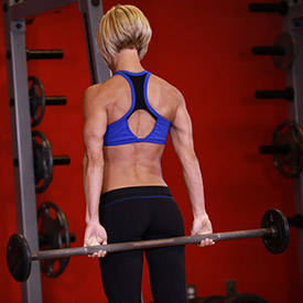 Standing palms-up barbell behind-the-back wrist curl