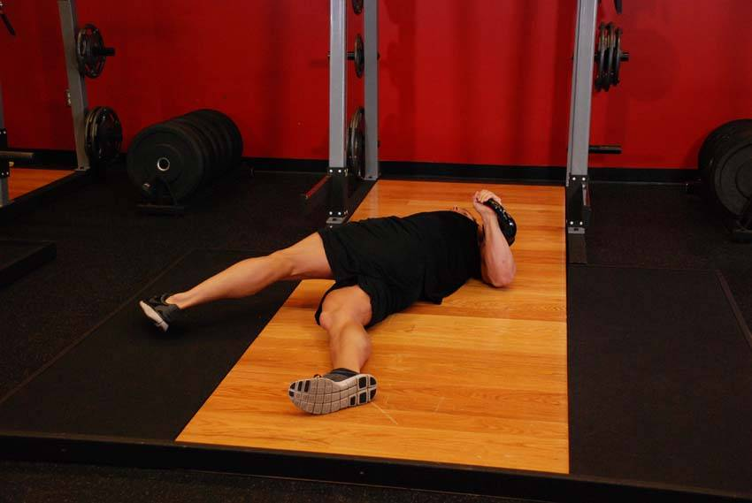 Leg over floor press exercise guide and video for Floor exercises
