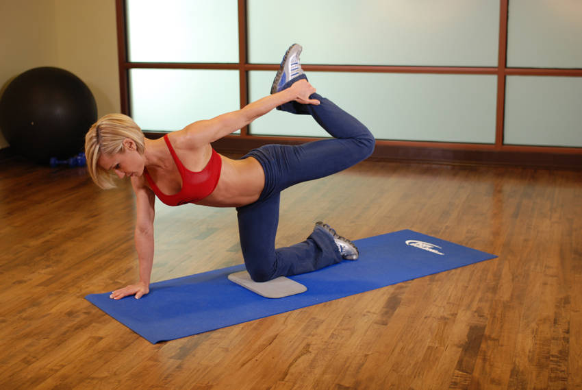 All fours quad stretch exercise guide and video for Floor quad stretch