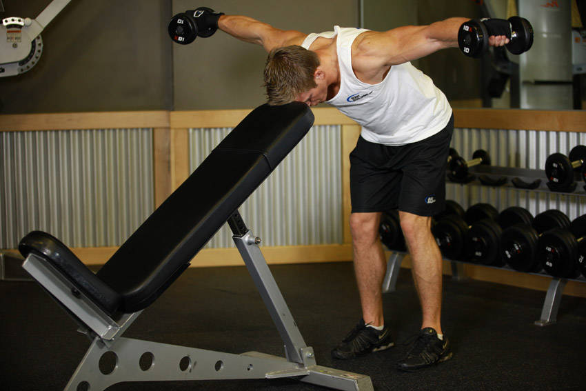 Bent over dumbbell rear delt raise with head on bench for Floor underhand cable fly