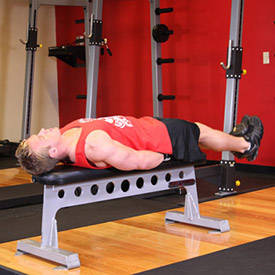 Flat bench lying leg raise: work your abs pre-turkey.