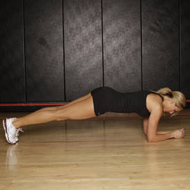 Plank with dumbbell grab