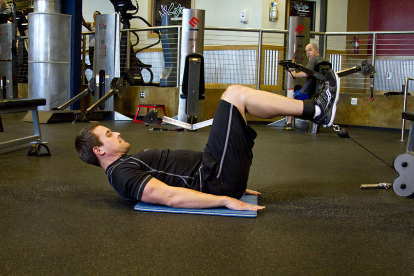 Cable Reverse Crunch Exercise Guide And Video
