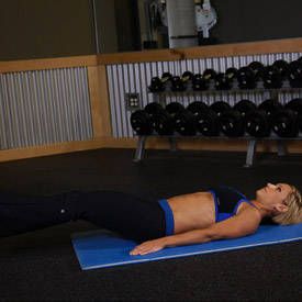 Stability-ball knee tuck