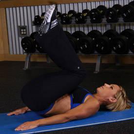 Stability-ball knee tuck