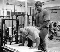 Dave Draper & Arnold repping out some donkey calf raises.