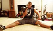 One-Arm Seated Kettlebell Military Press