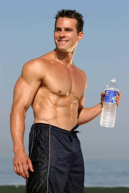 Man holding bottle of water