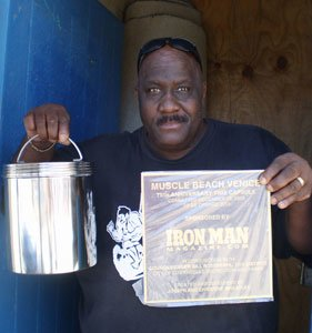 Joe Displays The Time Capsule That Will Be Buried Beneath The Muscle Beach Stage In December.
