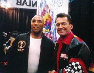 Leon Brown And Pro Mr. World Lee Labrada At The Arnold Classic Expo In 2002.