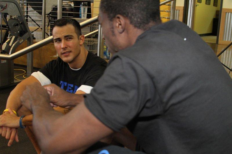 Man seeking advice in the gym