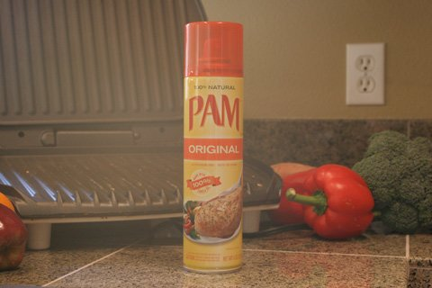 Spray the inside of the container with a non-stick cooking spray (a light coating will work) before you plop in your food