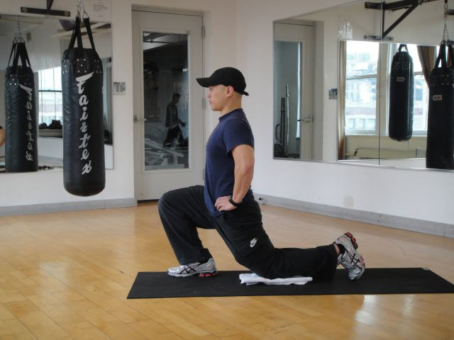 Half-kneeling dynamic hip flexor stretch