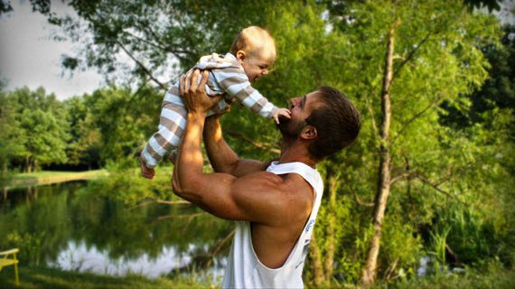 Father figure: When Ben isn't lifting weights, he hoists son Logan for reps.