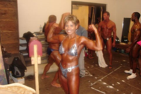 Military Bodybuilder Of The Month Maria Flores Shows Off Her Double Biceps Pose Backstage Before A Show.