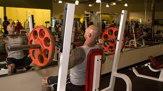 Do you suppose he's watching his form or 'spying' on fellow gym goers?