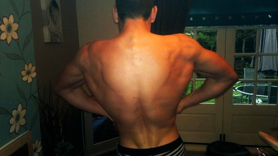 Lights out! Lewis spreads his lats like wings.