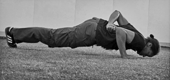 Asha Wagner, SFG Team Leader and veteran firefighter. The 1-arm push-up is required of all StrongFirst bodyweight instructors, male and female